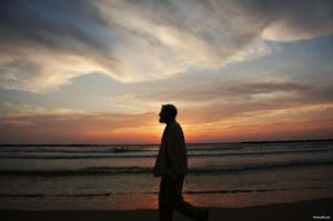 Man_walking_into_sunset-other